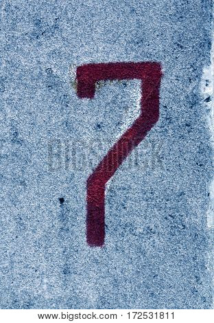 Number Seven On Blue Cement Wall.