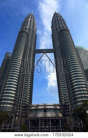 KUALA LUMPUR, MALAYSIA - JANUARY 31, 2016: Cloudscape view of the Petronas Twin Towers at Kuala Lumpur City Center. The most popular tourist destination in Malaysian capital