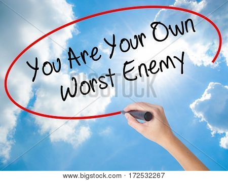 Woman Hand Writing You Are Your Own Worst Enemy With Black Marker On Visual Screen