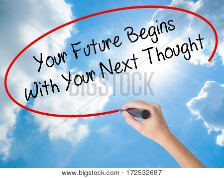 Woman Hand Writing Your Future Begins With Your Next Thought With Black Marker On Visual Screen.