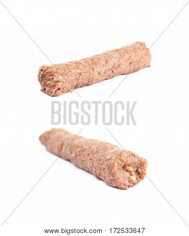 Raw kebab meat on a stick isolated over the white background, set of two different foreshortenings