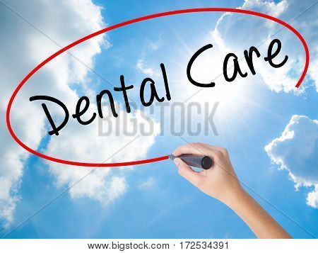 Woman Hand Writing Dental Care With Black Marker On Visual Screen