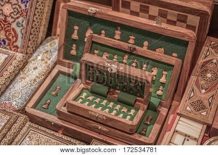 A chess board with chess wooden pieces