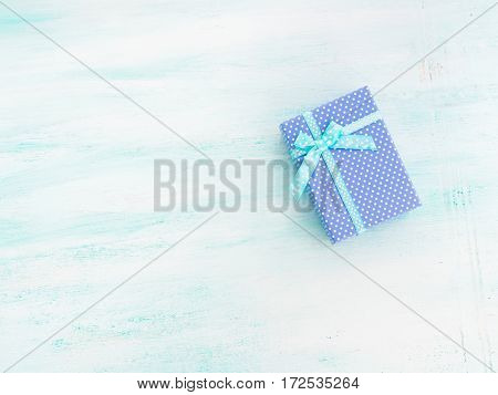 Blue gift box with ribbon on pastel background. Copy space top view father's day Christmas special occasion present