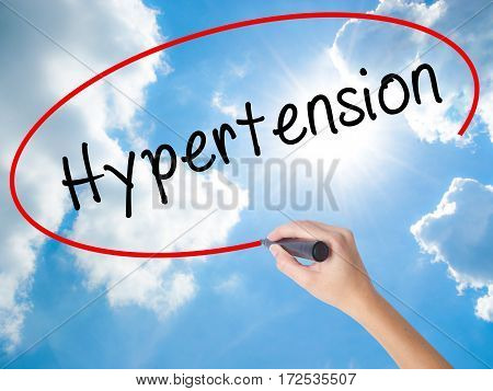 Woman Hand Writing Hypertension With Black Marker On Visual Screen