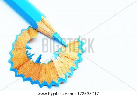 Sharpened Blue Color Pencil And Wood Shavings
