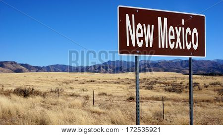 New Mexico road sign with blue sky and wilderness