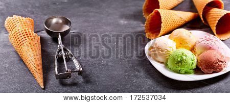 Various Ice Cream Scoops And Waffle Cones
