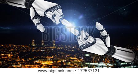 White robot arm pointing at something against high angle view of illuminated crowded cityscape 3d