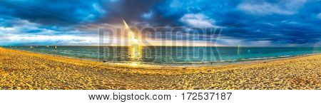 White sandy Flic en Flac beach at sunset. Mauritius. Panorama