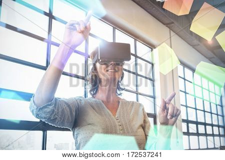 Digitally generated grey cubes floating against business executive wearing virtual reality headset 3d
