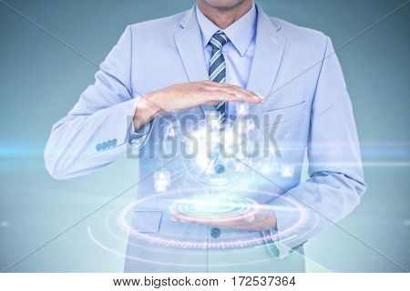 Handsome businessman gesturing with hands against digital interface of volume dial interface Handsome businessman gesturing with hands on a white background