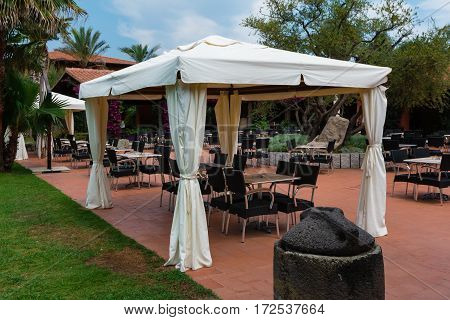 Chairs And Tables Under Gazebo With White Tent