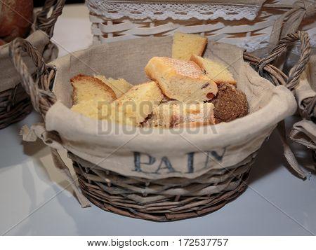 Slice Of Bread Rolls And French Loaf Inside Wicker Basket