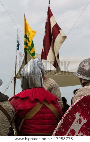 Knights with Silver Helmets and Shields seated on Chair: Medieval Event Reconstruction