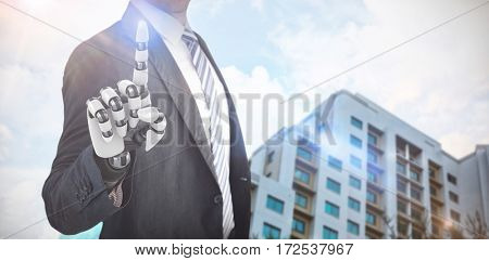 Composite of businessman with robotic hand against residential buildings against cloudy sky 3d