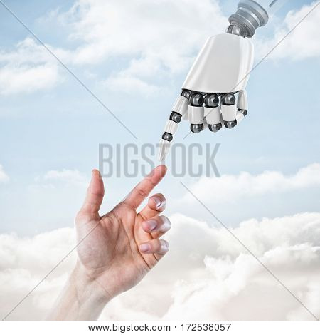 Hand of man pretending to touch an invisible screen against sky