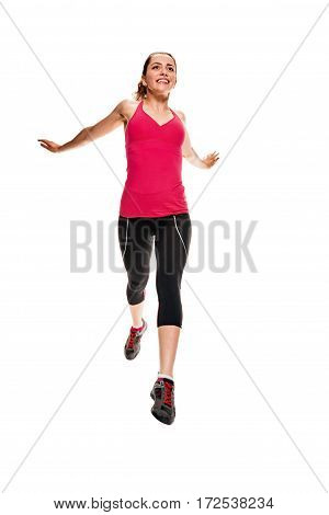 Young woman jumping or leaping forward isolated on white background