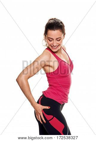 fitness and diet concept. sporty woman pointing at her buttocks
