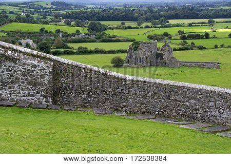 Castle ruins in the distance seen from Rock of Cashel, Ireland