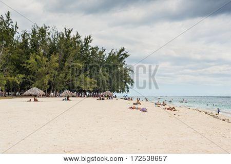 Flic en Flac Mauritius - December 9 2015: Overlooking the public beach of Flic en Flac in cloudy weather before the rain in Flic en Flac bay Mauritius.