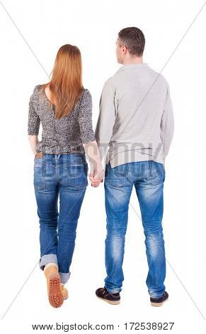 Back view of young embracing couple (man and woman) hug and look into the distance. beautiful friendly girl and guy together. Rear view people collection.  backside view of person.