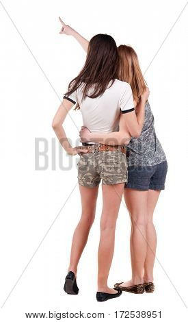 Two pointing young  women friend.  backside view of person. Isolated over white background. Rear view people collection.