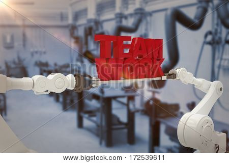 White robotic hand holding team work text against white background against various eqipments and pipes in factory