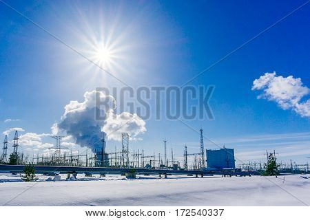 Landscape with view of Nuclear power Plant Clouds of thick smoke on blue sky background at Sunny day. Copy space