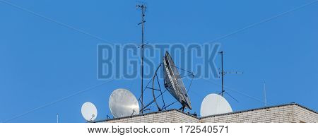 Telecommunication television Round antennas on the roof. Panoramic image