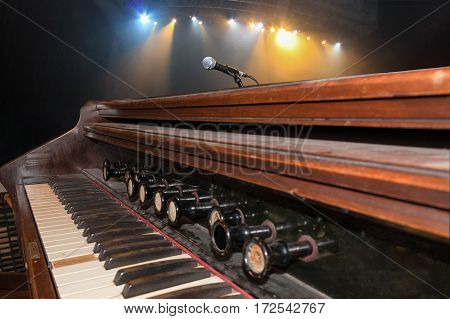 Old keys music instrument at a concert with focus on the foreground background out of focus.