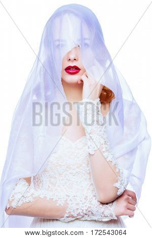 Portrait of a beautiful bride woman in white lace dress and veil. Wedding fashion. Beauty and cosmetics. Isolated over white.