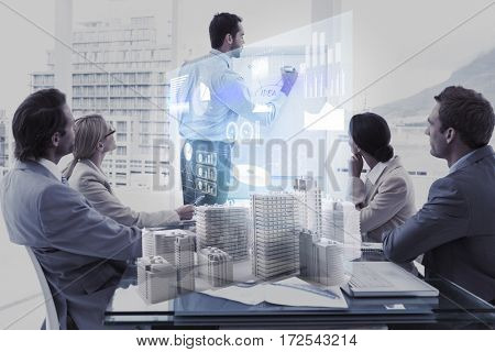 Skycrapers against composite image of business people and technology interface