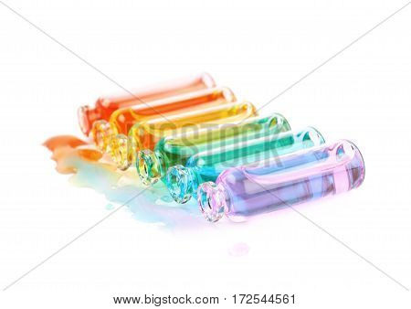 Set of multiple tiny glass vial bottles filled with the rainbow colored liquids, composition isolated over the white background
