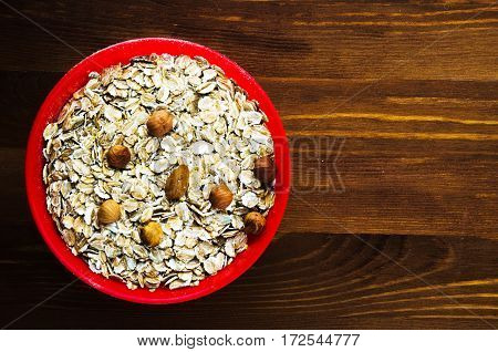 Oatmeal With Nuts (hazelnuts,  Almonds). Oatmeal On A Wooden Table. Oatmeal Top View. Healthy Food