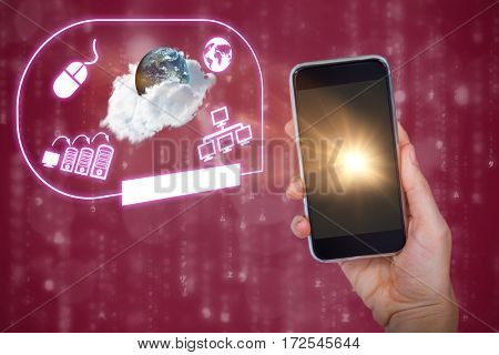 Hand holding mobile phone against earth on red background