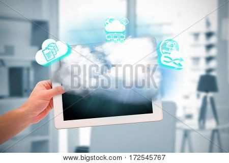 Masculine hand holding tablet against a model is posing on the table