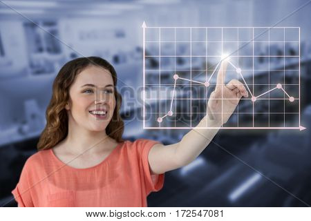 Beautiful young woman looking away against empty computer room