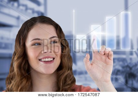 Beautiful happy young woman pointing against working desk in a office