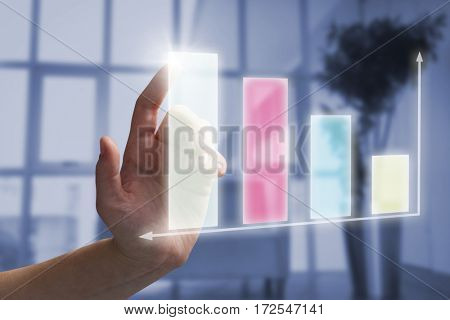 Close-up of cropped hand touching virtual graph against sofa chair in the office