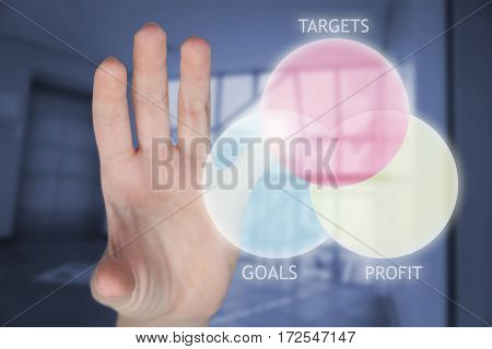 Cropped hand of woman gesturing against foyer area with elevator