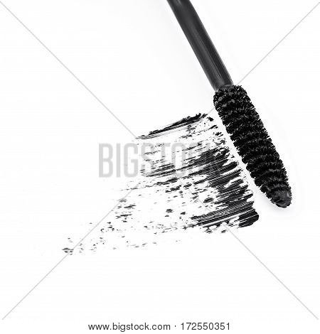 sample of brown mascara, isolated on white background