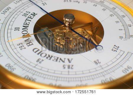 Closeup of  Aneroid barometer hygrometer thermometer device