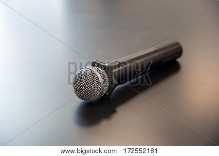 Microphone on the table. Wooden table glowing