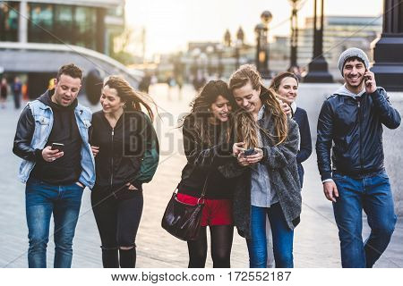 Group Of Friends With Mobile Phones In London