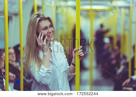 Young Woman Talking On The Phone While Commuting