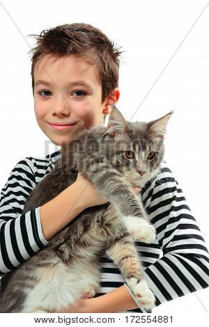 Boy with his kitten Maine coon on white background