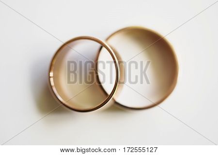 Wedding rings on a white background wedding bands infinity sign of the rings