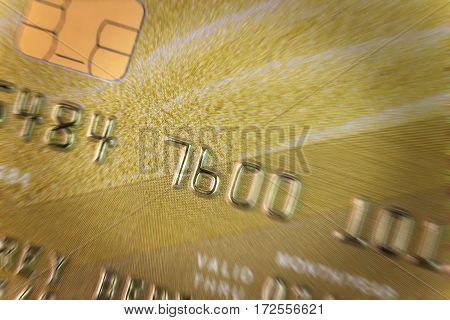 fragment of a gold credit card with effect in motion blur closeup
