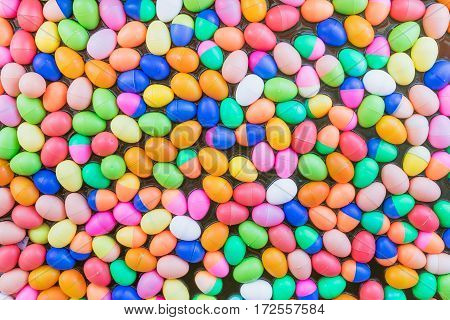 The Colorful easter eggsColorful plastic eggs toys floating on the water background
